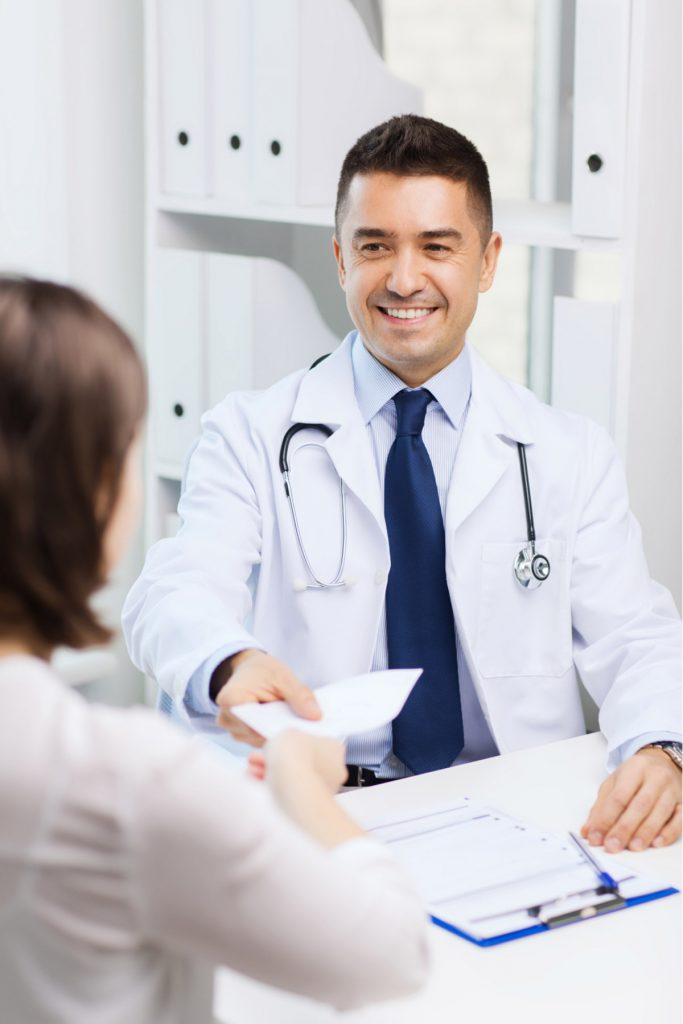 Doctor smiling while talking to patient